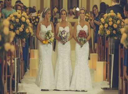 Identical triplets Rafaela Bini, Rocheli Bini and Tagiane Bini got married to their respective husbands together at Catedral Nossa Senhora Aparecida in Passo Fundo, Brazil, March 21, 2015.