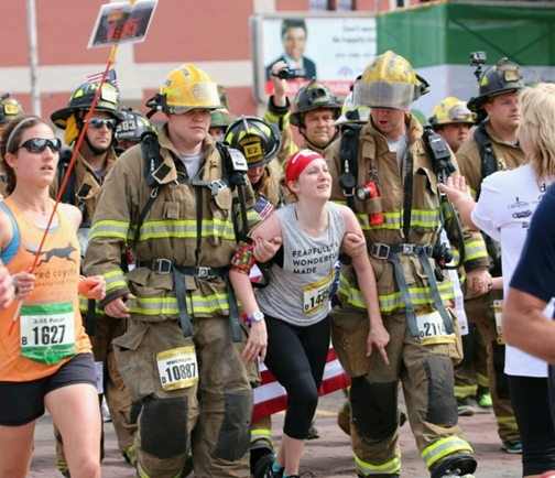 Midwest City Firefighters Caleb Bryant and Garret Matlock helped a woman finish the latter part of the half marathon