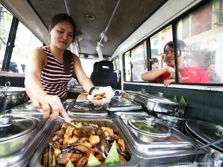 woman converts her van into a carinderia selling affordable meal packages along Padre Faura Street in Manila on Saturday May 16, 2015